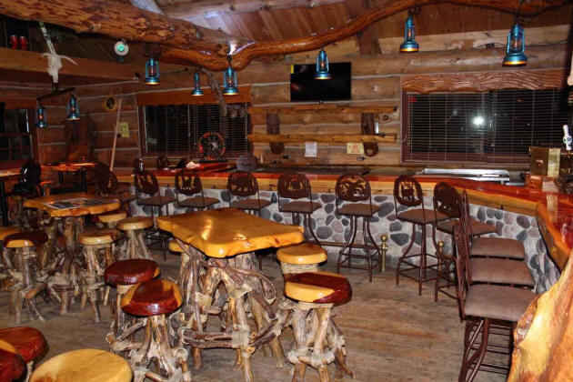 commercial bar in a rustic lodge setting shown Grace bar stools bases and the bar surface height