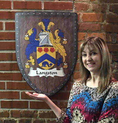Melody with custom coat of arms on brick wall