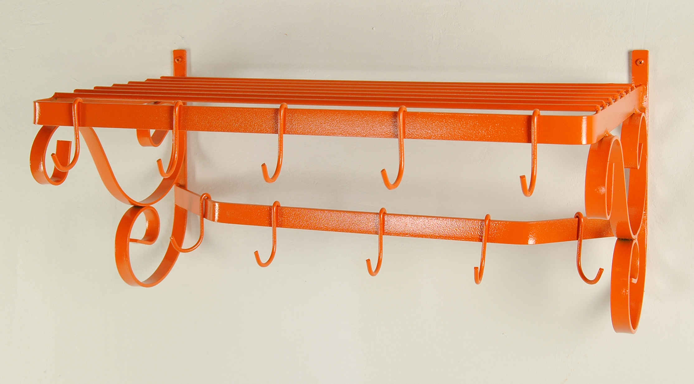 wall mounted pot rack in bold tangerine orange finish